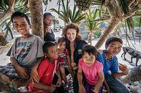 Dr Sevil Huseynova, WHO Representative in Solomon Islands with children.