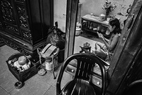 At 19:30, a sex worker prepares for work in her small apartment where she lives with her mother and 2 year old baby in Hanoi, Viet Nam.