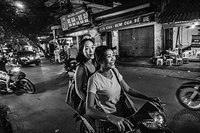 A sex worker goes to work with her friend's motorbike in Hanoi, Viet Nam.
