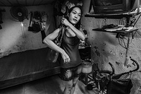 A sex worker leaves her apartment for work in Hanoi, Viet Nam.