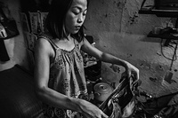 At 19:30, a sex worker prepares herself for work in her small apartment where she lives with her mother and 2 year old baby in Hanoi, Viet Nam.