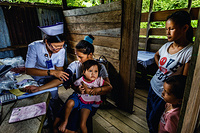 Health workers from Flying Doctor Service provide health care in the village of  Ba Ajeng.  The Flying Doctor Service was introduced in 1973 to provide basic health services to people living in remote areas. The helicopters are based in Kuching, Sibu and Miri and together, they cover 141 locations in the remote rural with a attends of about 70 000 outpatients, children and antenatal mothers every year. The Flying Doctor team comprises a medical officer, a medical assistant and two community nurses who visit the locations once a month or once in two months. The Flying Doctor Service also provides medical emergency evacuation (MEDEVAC) of seriously ill patients from the locality to the nearest appropriate hospital, from rural health clinics to hospital and from hospital to hospital. It also served as cargo run to rural health clinics in delivering medical items and drugs. During disease outbreak in the state, the Flying Doctor Service helicopters are also used for quick transportation of field investigation and control medical and health teams.