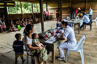 Health workers from Flying Doctor Service provide health care in the village of  Ba Lamam.  The Flying Doctor Service was introduced in 1973 to provide basic health services to people living in remote areas. The helicopters are based in Kuching, Sibu and Miri and together, they cover 141 locations in the remote rural with a attends of about 70 000 outpatients, children and antenatal mothers every year. The Flying Doctor team comprises a medical officer, a medical assistant and two community nurses who visit the locations once a month or once in two months. The Flying Doctor Service also provides medical emergency evacuation (MEDEVAC) of seriously ill patients from the locality to the nearest appropriate hospital, from rural health clinics to hospital and from hospital to hospital. It also served as cargo run to rural health clinics in delivering medical items and drugs. During disease outbreak in the state, the Flying Doctor Service helicopters are also used for quick transportation of field investigation and control medical and health teams.