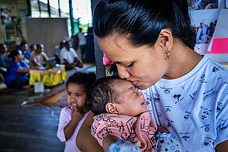 Mother and child at a tuberculosis screening at a community center in Suva, Fiji.