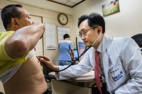 A doctor check a patient at Seoul National University Hospital