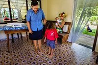 A health worker conducting a routine check-up at Te Piri Community Clinic in Rarotonga.