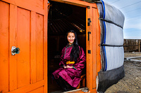 A woman inside a Ger, a portable  round tent covered with skins, in Darkhan.