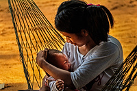 Mother and her baby wait their turn to receive vaccinations at a local clinic in Siem Reap