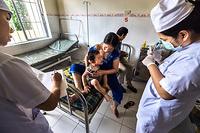 Nurses take blood for testing at Khanh Vinh district hospital in Khanh Hoa province, Viet Nam