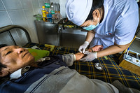 A nurse takes blood for testing at Khanh Vinh district hospital in Khanh Hoa province, Viet Nam