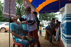 A health worker gives oral cholera vaccine. Note: The Ministry of Health with support from UNICEF and the World Health Organization has launched the first cholera vaccination campaign in Lao PDR targeting flood-affected communities,  23 to 30 August 2018.