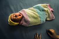 A baby falls asleep after bathing at Khanh Vinh district hospital in Khanh Hoa province