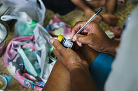 Home Based Care / Photo essay:  A nurse visits and provides a foot care at the home of a diabetic patient in Suva.