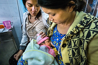 Surrogate breastfeeding: two mothers -  one of them supports the other's baby with breastfeeding at the Khanh Vinh district hospital in Khanh Hoa province