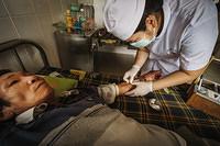 A nurse takes blood for testing at Khanh Vinh district hospital in Khanh Hoa province, Viet Nam