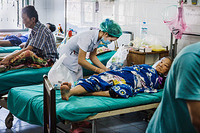 A nurse makes a routine visit to the in-patient ward at Mahosot hospital in Vientiane, Lao People's Democratic Republic.