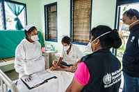 WHO staff visiting the TB ward in Tungaru Central Hospital