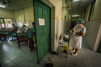 A nurse makes a routine visit to patients at Mahosot hospital in Vientiane, Lao People's Democratic Republic.