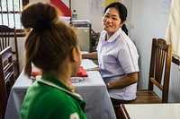 A nurse provides counselling on sexually transmitted infections (STIs) to a female sex worker