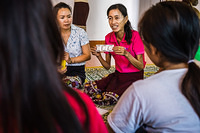 Sex workers counselling on use of condom at a drop in center in Vientiane