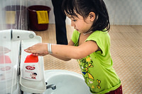 A girl washes her hands before lunch at a kindergarten in Khanh Hoa province