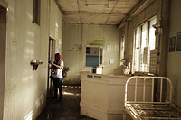 Aphaluck Batiasevi, Technical Officer, Experts Networks & Interventions, inspecting a damaged hospital, Eastern Samar  Note: Titles of staff/delegates reflect their respective position at the time the photo was taken