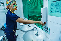 Washing of hands before before delivering a baby in Dr Jose Fabella Memorial Hospital.