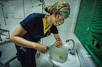 Proper hand washing before delivering a baby in Dr Jose Fabella Memorial Hospital.