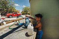 A boy accessing water through distribution center.