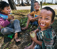 Children laughing and eating.