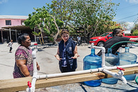 Dr Sevil Huseynova, WHO Representative in Solomon Islands, visiting a water distribution station.
